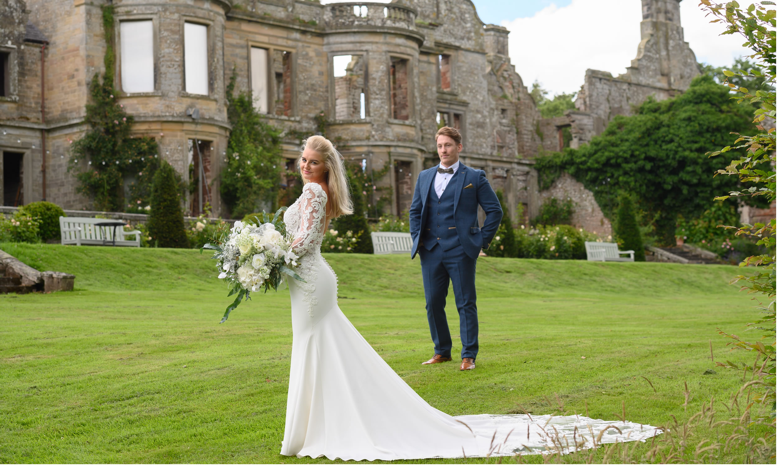 Bride and groom dressed by Carols Bridal Boutique Carlisle